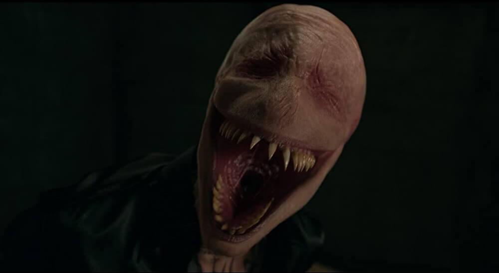 Dustin Ceithamer als de Smiling Man
